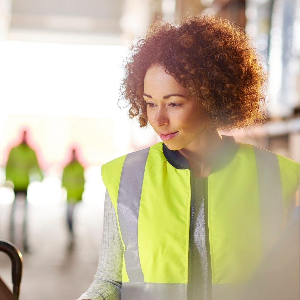 Woman planning in warehouse for peak season
